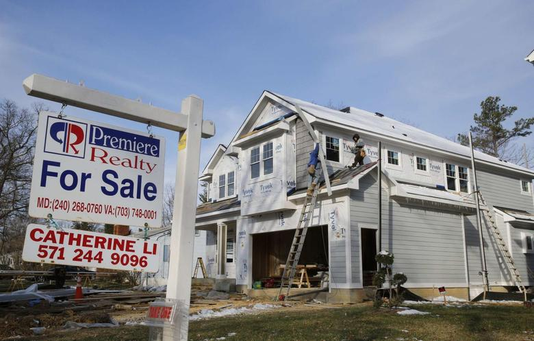 A new home is being built next to a home with a for sale sign on a street in Vienna, in Virginia March 27, 2014.      REUTERS/Larry Downing