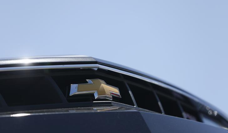 The Chevrolet logo is pictured on the front of a Chevrolet Camaro for sale at a car dealership in Los Angeles, California April 1, 2014. REUTERS/Mario Anzuoni