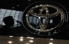 A visitor is reflected on a Toyota car at the company's showroom in Tokyo October 18, 2012. REUTERS/Toru Hanai