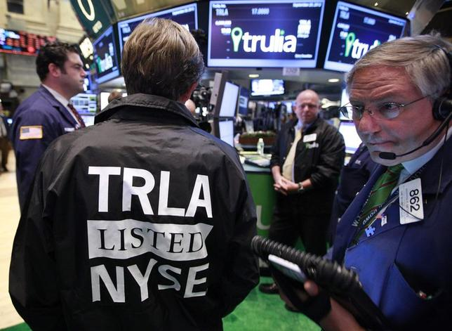 Traders work at the post that trades Trulia Inc. on the floor of the New York Stock Exchange, in this file photo taken September 20, 2012. REUTERS/Brendan McDermid/Files