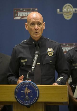 Commander Andrew J. Smith, public information officer at the Los Angeles Police Department, speaks during a news conference in Los Angeles, California July 28, 2014 REUTERS/Mario Anzuoni