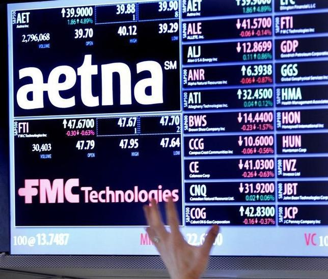 A trader points up at a display on the floor of the New York Stock Exchange August 20, 2012.  REUTERS/Brendan McDermid