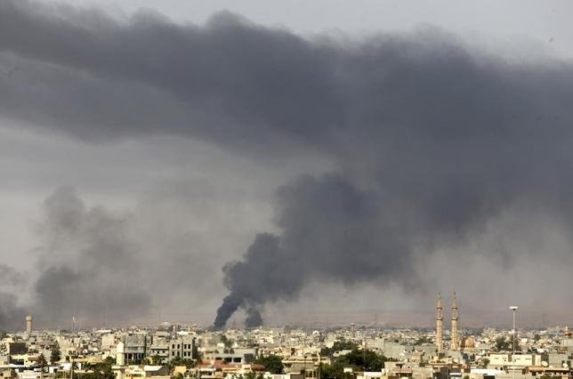 Black plumes of smoke is seen in the vicinity of Camp Thunderbolt, after clashes between militants, former rebel fighters and government forces in Benghazi July 27, 2014. . REUTERS/Esam Omran Al-Fetori