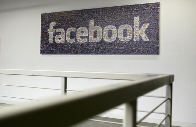 The Facebook logo is pictured in the Facebook headquarters in Menlo Park, California January 29, 2013.  REUTERS/Robert Galbraith/Files