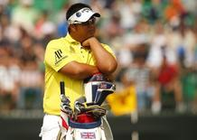 Kiradech Aphibarnrat of Thailand waits on the fourth hole during the second round of the British Open Championship at the Royal Liverpool Golf Club in Hoylake, northern England July 18, 2014.           REUTERS/Cathal McNaughton