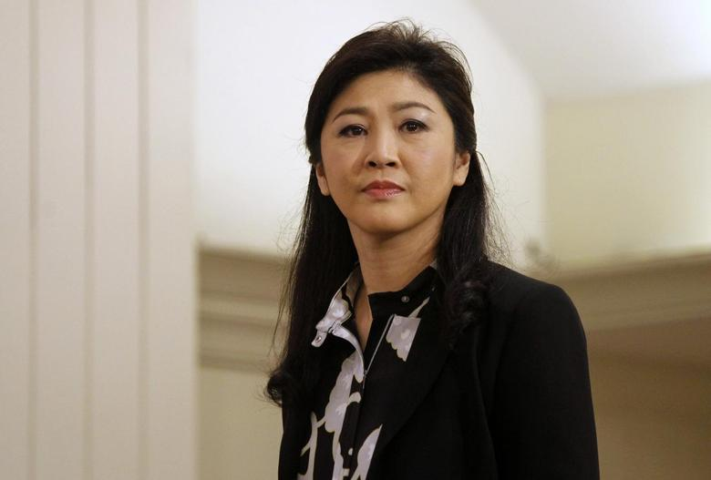 Former Thai Prime Minister Yingluck Shinawatra arrives at a hotel for a news conference in Bangkok July 18, 2014.  REUTERS/Chaiwat Subprasom