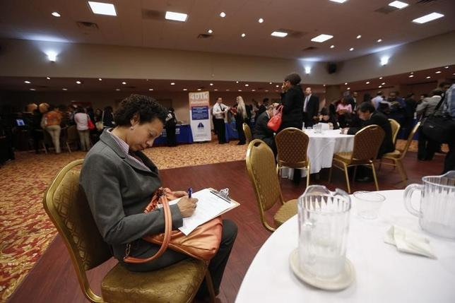 A woman fills out a job application as she attends a job fair in New York, June 11, 2013. REUTERS/Lucas Jackson