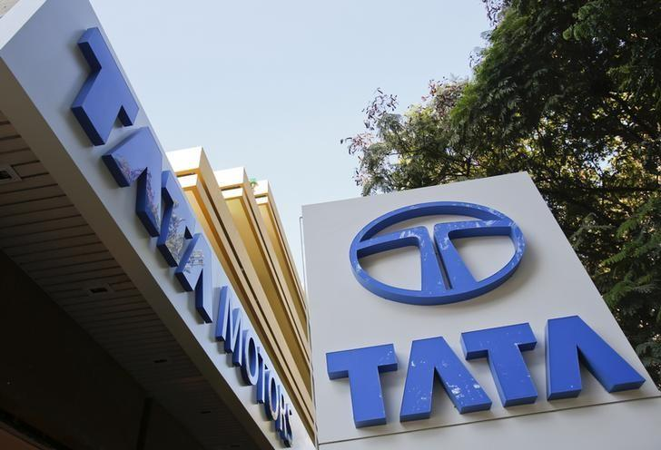 Tata Motors logos are pictured outside their flagship showroom in Mumbai May 28, 2013.  REUTERS/Vivek Prakash/Files