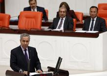 Turkey's Deputy Prime Minister Bulent Arinc addresses the Turkish Parliament in Ankara October 31, 2013.  REUTERS/Umit Bektas
