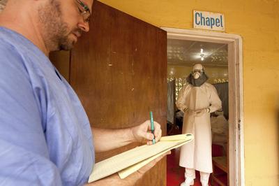 U.S. relief worker 'fighting through' Ebola virus: son