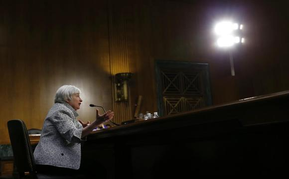 Fed presses forward with bond buying, cites uptick in inflation