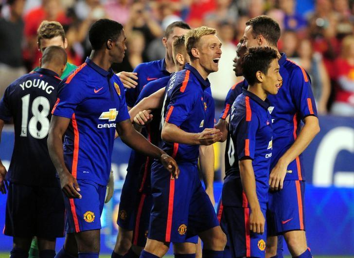 Jul 29, 2014; Landover, MD, USA; Manchester United midfielder Darren Fletcher (24) is congratulated by teammates after making the winning penalty kick to beat Inter Milan 5-3 at FedEx Field. Evan Habeeb-USA TODAY Sports