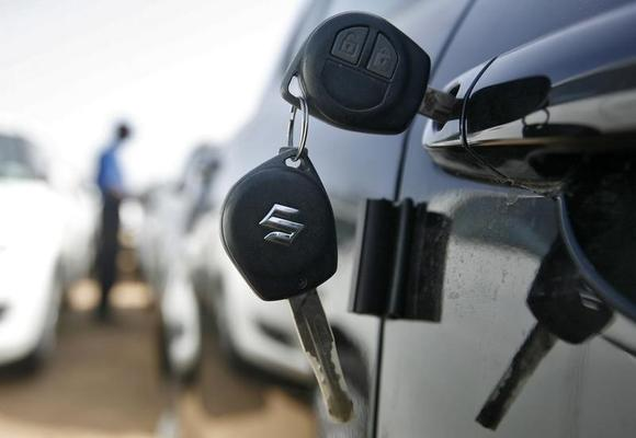 Keys hang from the door of a Maruti Suzuki Swift car at its stockyard on the outskirts of Ahmedabad April 26, 2013. REUTERS/Amit Dave/Files