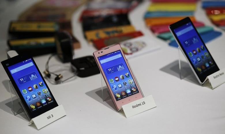 Three models of China's Xiaomi Mi phones are pictured during their launch in New Delhi July 15, 2014. REUTERS/Anindito Mukherjee/Files