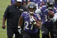 Baltimore Ravens running back Ray Rice (27) runs with the ball during practice at Under Armour Performance Center on July 24, 2014. USA TODAY Sports/Tommy Gilligan