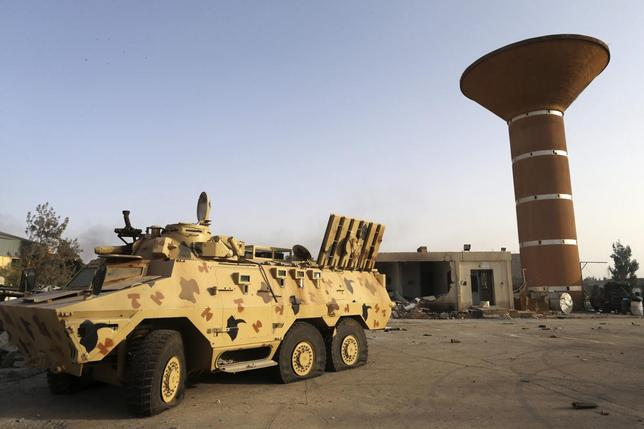 An armoured vehicle is seen after fighting between Libyan special forces and ex-rebel fighters of the Benghazi Shura Council in the eastern city of Benghazi July 30, 2014.  REUTERS/Stringer
