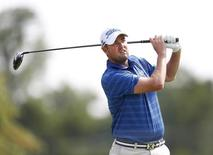 Jul 31, 2014; Akron, OH, USA; Marc Leishman tees off on the eighth hole during the first round of the WGC-Bridgestone Invitational golf tournament at Firestone Country Club - South Course. Mandatory Credit: Joe Maiorana-USA TODAY Sports