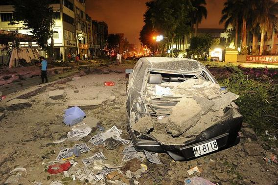 Wreckage of a car is pictured after an explosion in Kaohsiung, southern Taiwan, August 1, 2014. REUTERS/Stringer