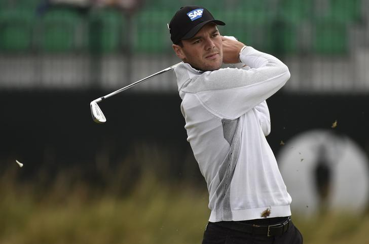 Martin Kaymer of Germany watches his tee shot on the fourth hole during a practice round ahead of the British Open Championship at the Royal Liverpool Golf Club in Hoylake, northern England July 16, 2014. REUTERS/Toby Melville