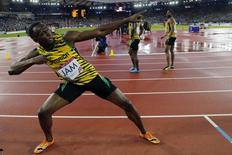 Jamaica's Usain Bolt poses after Jamaica won the men's 4x100m relay final at the 2014 Commonwealth Games in Glasgow, Scotland, August 2, 2014.                  REUTERS/Suzanne Plunkett