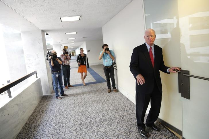 Ranking member Senator Saxby Chambliss (R-GA) (R) turns to answer a reporter's question as he arrives for a closed Senate Select Intelligence Committee hearing, to be briefed by U.S. Deputy Director of National Intelligence Robert Cardillo (not pictured), on Capitol Hill in Washington, September 10, 2013. REUTERS/Jonathan Ernst