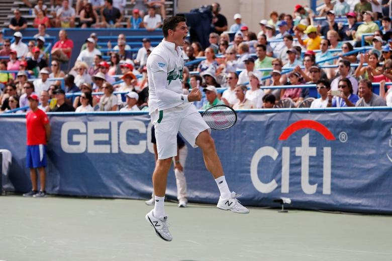 Aug 3, 2014; Washington, DC, USA; Milos Raonic celebrates after defeating Vasek Pospisil (not pictured) in the men's singles final on day seven of the Citi Open tennis tournament at the Fitzgerald Tennis Center. Raonic won 6-1, 6-4.  Geoff Burke-USA TODAY Sports