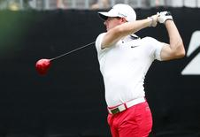 Aug 2, 2014; Akron, OH, USA; Rory McIlroy tees off on the tenth hole during the third round of the WGC-Bridgestone Invitational golf tournament at Firestone Country Club - South Course. Joe Maiorana-USA TODAY Sports
