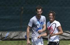 Amelie Mauresmo, newly appointed coach of Britain's Andy Murray, joins Murray for a training sesssion at the Wimbledon Tennis Championships, in London July 1, 2014.       REUTERS/Toby Melville