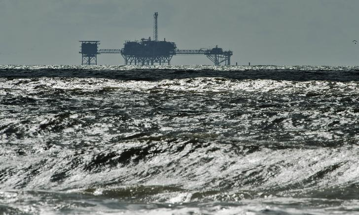 An oil and gas drilling platform stands offshore of Dauphin Island, Alabama, October 5, 2013. REUTERS/Steve Nesius