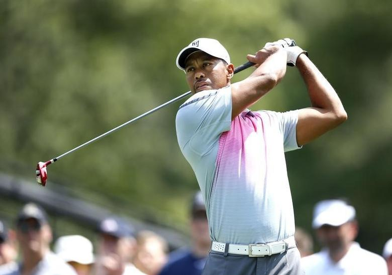 Jul 31, 2014; Akron, OH, USA; Tiger Woods drives on the sixth hole during the first round of the WGC-Bridgestone Invitational golf tournament at Firestone Country Club - South Course. Joe Maiorana-USA TODAY Sports