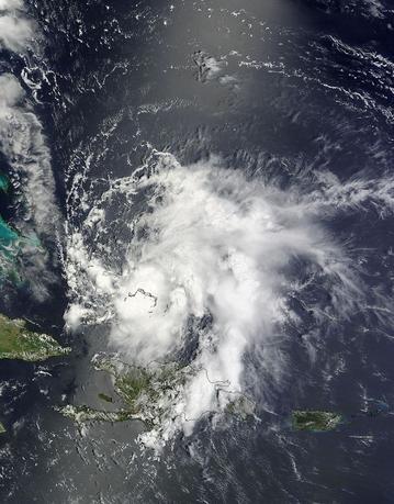 Tropical Storm Bertha passes over the Bahamas in this August 3, 2014 NASA handout satellite photo.   REUTERS/NASA MODIS Rapid Response Team/Handout via Reuters