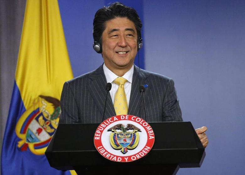 Japan's Prime Minister Shinzo Abe smiles during a news conference at the presidential palace in Bogota July 29, 2014. REUTERS/John Vizcaino