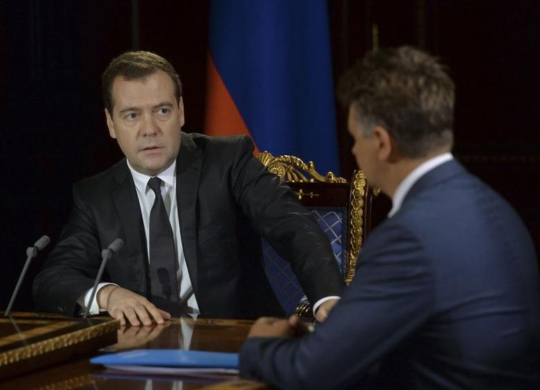 Russia's Prime Minister Dmitry Medvedev (L) meets with Transport Minister Maxim Sokolov and Aeroflot Deputy General Director Vadim Zingman (not pictured) at the Gorki state residence outside Moscow, August 5, 2014. REUTERS/Alexander Astafyev/RIA Novosti/Pool