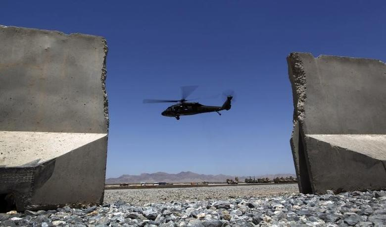 A Black Hawk helicopter takes off from Forward Operating Base Apache in Afghanistan's Zabul Province May 23, 2012.    REUTERS/Tim Wimborne