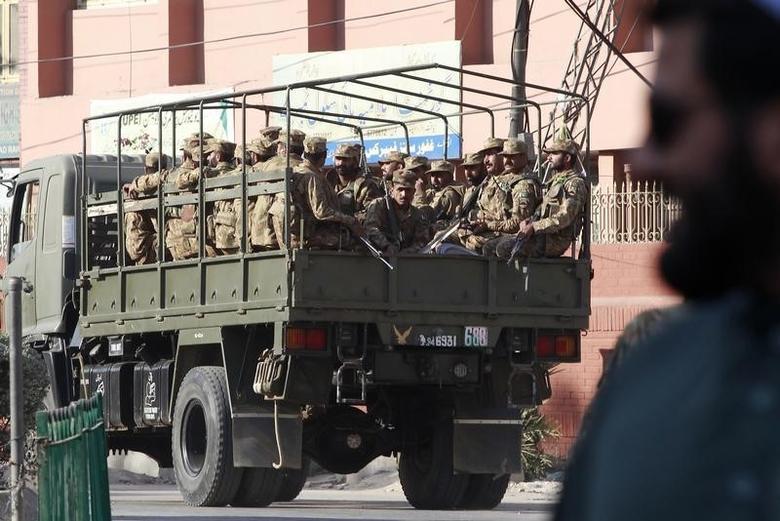 Pakistan army soldiers patrol a street during a curfew in Rawalpindi November 17, 2013. REUTERS/Mian Khursheed