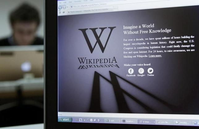 A reporter's laptop shows the Wikipedia blacked out opening page in Brussels January 18, 2012. REUTERS/Yves Herman/Files