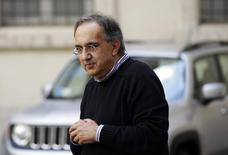 """Fiat Chief Executive Sergio Marchionne looks on during a meeting with Italian Prime Minister Matteo Renzi (not pictured) to mark the presentation of new """"Jeep Renegade"""" car at Chigi palace, in Rome July 25, 2014.  REUTERS/ Max Rossi"""