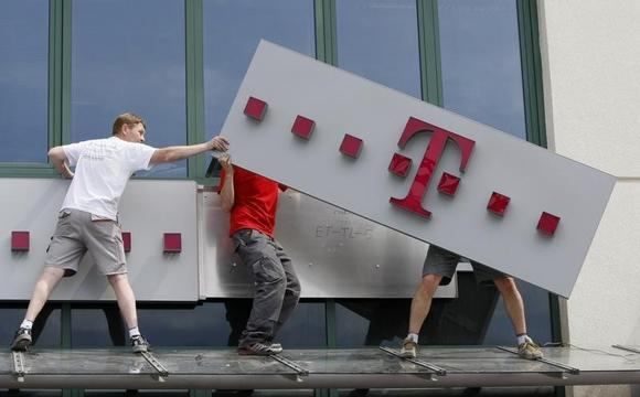 File photo of a T-Mobile logo being positioned on a shop front in Warsaw June 1, 2011. REUTERS/Kacper Pempel/Files