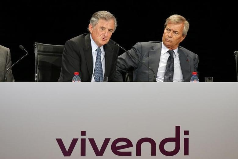 Vincent Bollore (R), the current vice-chairman of Vivendi and largest shareholder, listens as Vivendi's outgoing Chairman Jean-Rene Fourtou speaks at the company's shareholders meeting in Paris, June 24, 2014. REUTERS/Benoit Tessier