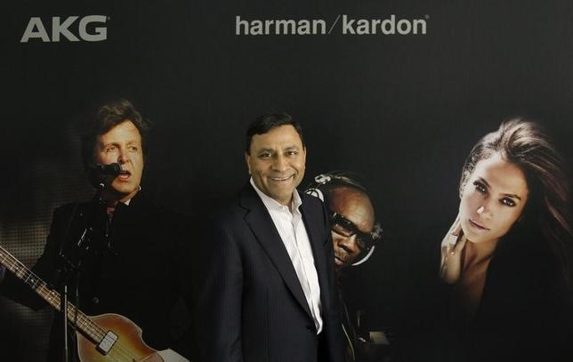 CEO of Harman International Industries Dinesh Paliwal poses during a Reuters interview during the opening day of the IFA consumer electronics fair in Berlin, August 31, 2012. REUTERS/Tobias Schwarz