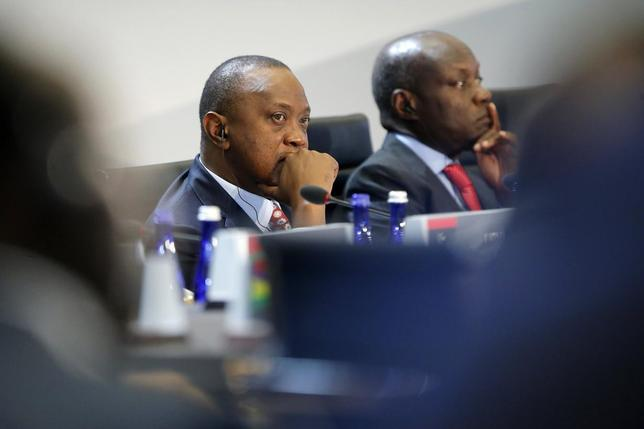Kenya's President Uhuru Kenyatta listens to opening remarks at the start of the U.S.-Africa Leaders Summit Session One on 'Investing in Africa's Future', at the U.S. State Department in Washington August 6, 2014. Also pictured is Guinea-Bissau's President Jose Mario Vaz (R). REUTERS/Jonathan Ernst    L
