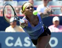 Aug 8, 2014; Montreal, Quebec, Canada; Serena Williams (USA) hits a forehand against Caroline Wozniacki (DEN) on day five of the Rogers Cup tennis tournament at Uniprix Stadium. Eric Bolte-USA TODAY Sports
