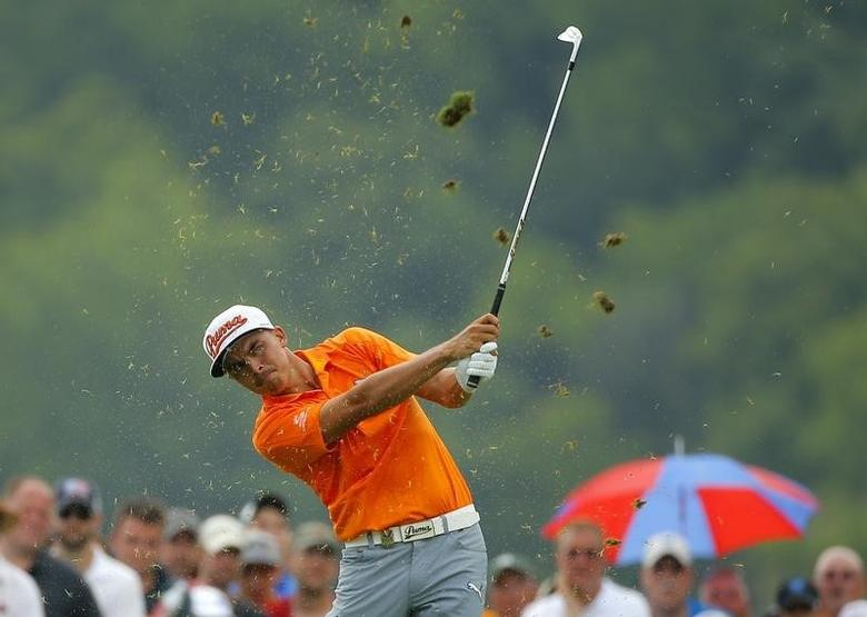 Rickie Fowler of the U.S. hits off the 8th tee during the final round of the 2014 PGA Championship at Valhalla Golf Club in Louisville, Kentucky, August 10, 2014. REUTERS/Brian Snyder