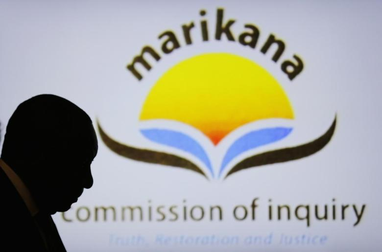 South African Deputy President Cyril Ramaphosa is silhouetted in the Farlam Commission, in Centurion, outside Pretoria August 11, 2014. REUTERS/Siphiwe Sibeko