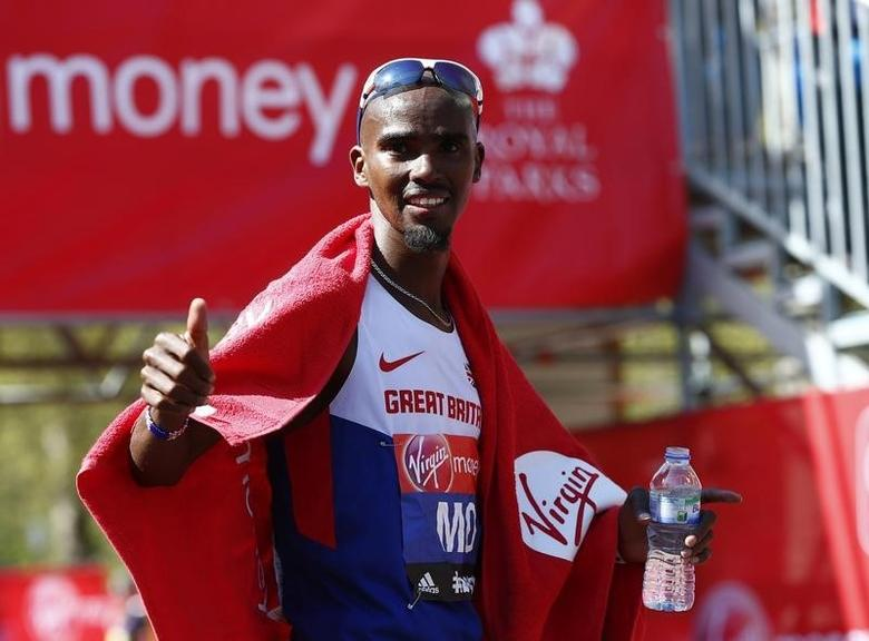 Mo Farah of Britain gestures after finishing in eighth position in the men's Elite London Marathon April 13, 2014.         REUTERS/Eddie Keogh