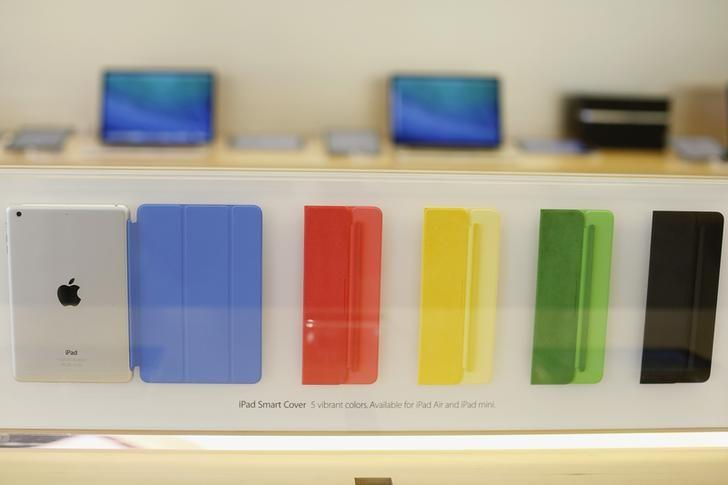 A collection of Apple iPad Smart Covers are seen at the Apple store in San Francisco, California November 1, 2013.  REUTERS/Stephen Lam/Files