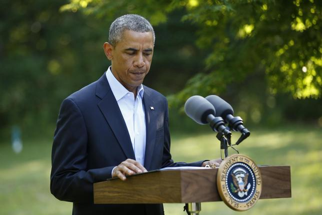 U.S. President Barack Obama delivers a statement on the situation in Iraq from his vacation compound at Martha's Vineyard, Massachusetts August 11, 2014.  REUTERS/Kevin Lamarque