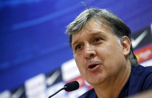 Barcelona's coach Gerardo Martino attends a news conference at Joan Gamper training camp, near Barcelona in this May 16, 2014 file photo. REUTERS/Albert Gea