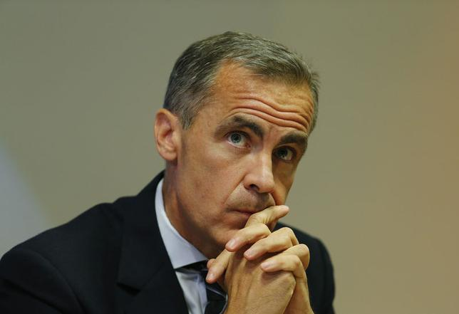 Bank of England Governor Mark Carney listens to a journalist's question during the bank's quarterly inflation report news conference at the Bank of England in London August 13, 2014.  REUTERS/Suzanne Plunkett