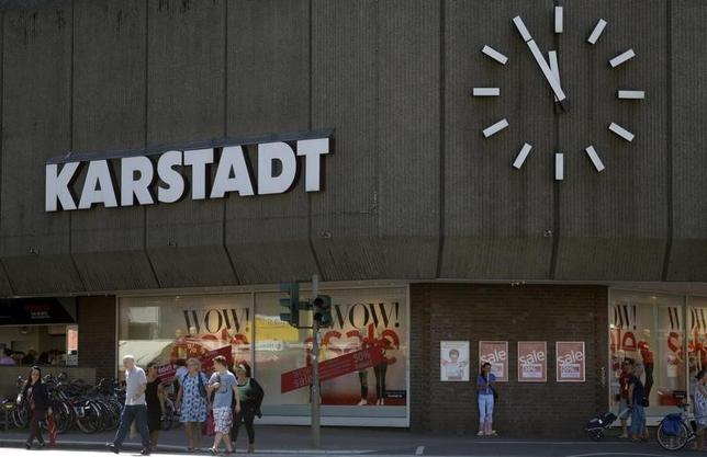 A clock showing five minutes to noon is seen at an outlet of the German department store chain Karstadt in Hamburg, July 11, 2014. REUTERS/Fabian Bimmer